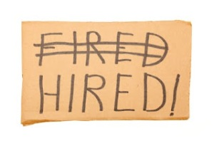 "Cardboard sign with the words ""Fired"", ""Hired"